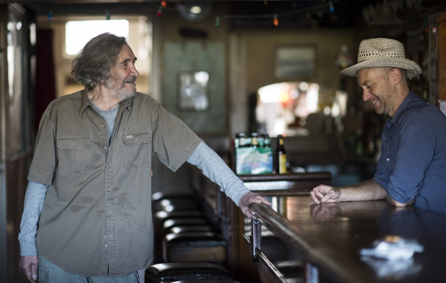 Bartender Sunny Balzano (left) transformed a longshoremen's bar in Red Hook, Brooklyn into a local institution. He's pictured above with Tim Sultan, who recounts Balzano's story in <em>Sunny's Nights.</em>