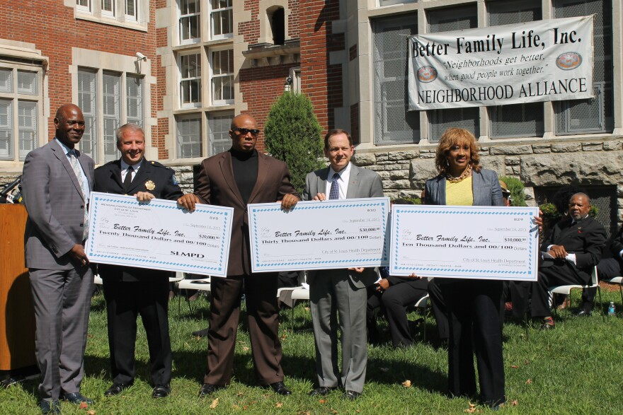 (Right to Left) Melba Moore, director of the St. Louis Department of Health, Mayor Francis Slay, Better Family Life Director James Clark, and Metro Police Chief Sam Dotson pose with checks representing the money given to an anti-gun-violence program run o