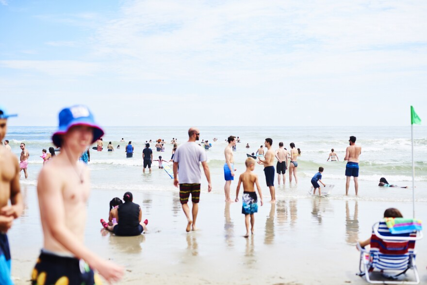 People roamed the beach in Ocean City, N.J, at the start of August. As Labor Day weekend arrives, Dr. Anthony Fauci, director of the National Institute of Allergy and Infectious Diseases, says Americans should remain vigilant to avoid another surge in coronavirus infection rates.