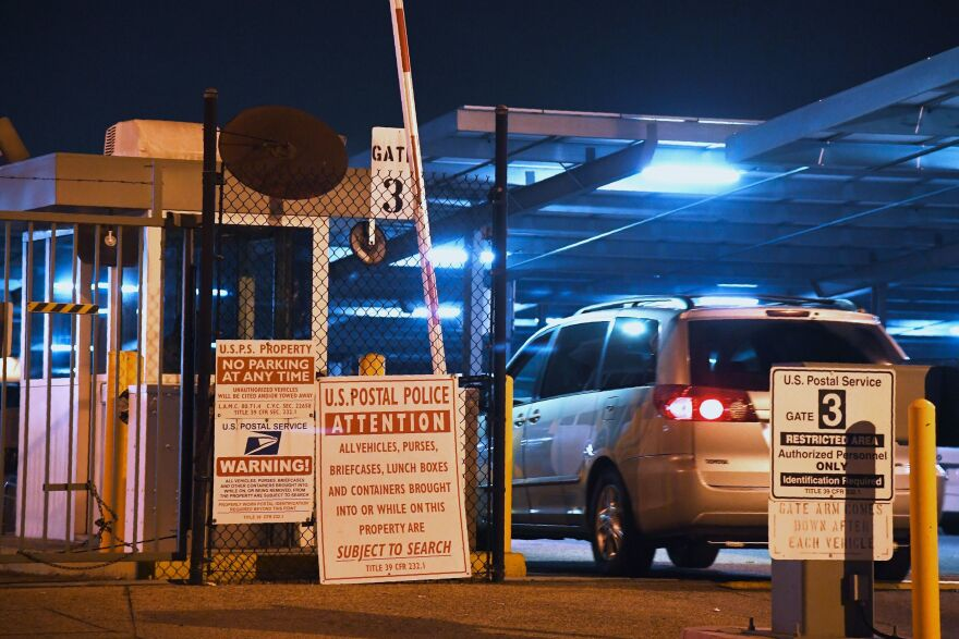 A car enters the United States Postal Service Processing and Distribution Center in Los Angeles on Wednesday.