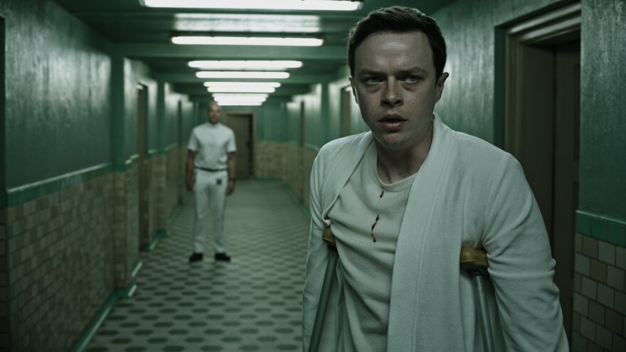 A Wall Street trader (Dane DeHaan) finds himself in sinister ... crutches ... in <em>A Cure For Wellness.</em>