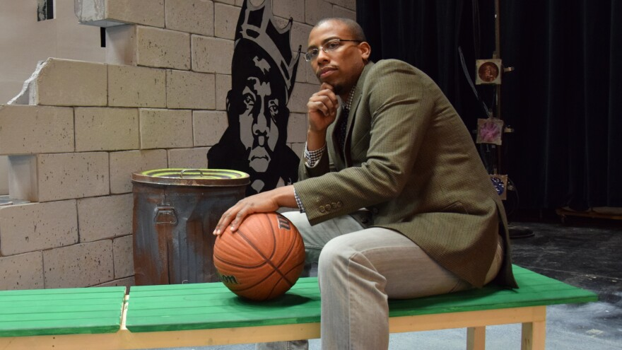 Onaje X. O. Woodbine's book, <em>Black Gods of the Asphalt</em>, has also been adapted into a play by the same name. He appears here on that play's set at Phillips Academy in Andover, Mass.