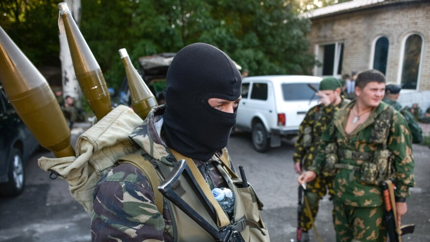 Pro-Russian rebels prepare their weapons in the eastern city of Donetsk on Aug. 31. Russia's role in Ukraine has raised tensions between Russia and NATO to their highest level since the Soviet breakup more than two decades ago.