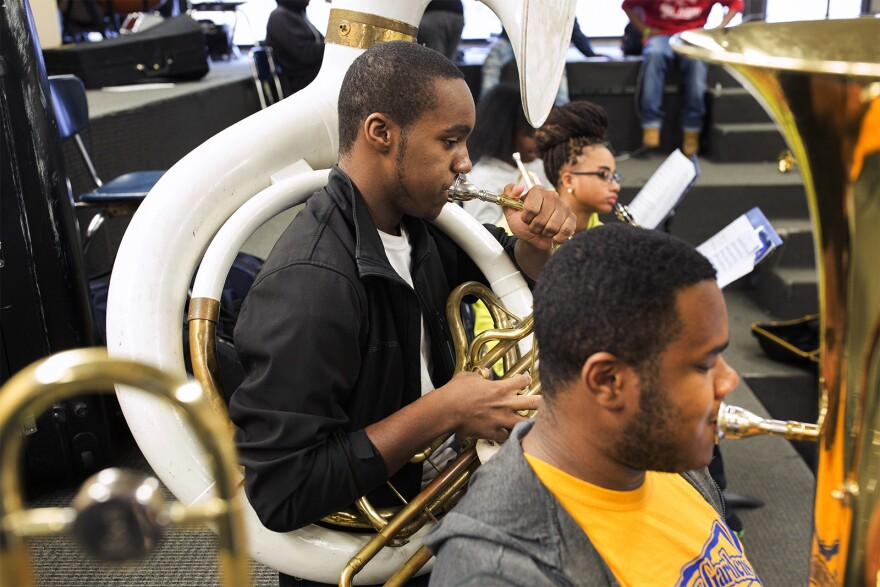 Noel Richee, center, and Keyon Moore practice during a recent band rehearsal at Riverview Gardens High School. (Jan. 17, 2017)