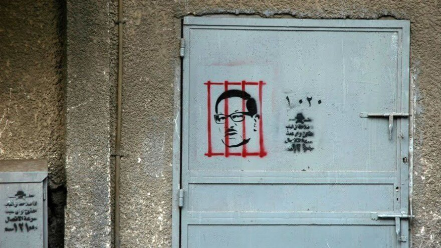 After the revolution, graphic artist Adham Bakry began stenciling the face of Safwat El Sherif, a member of Egypt's former ruling party, behind bars. El Sherif was arrested on corruption charges soon after. Bakry sees the rise of Cairo's street art as a push back against those who use the uprising as a marketing tool.