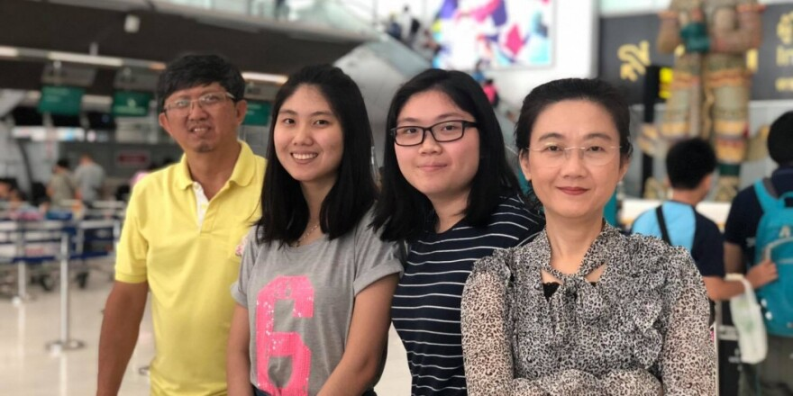 Beam Throngprasertchai and family pose for a picture at the airport