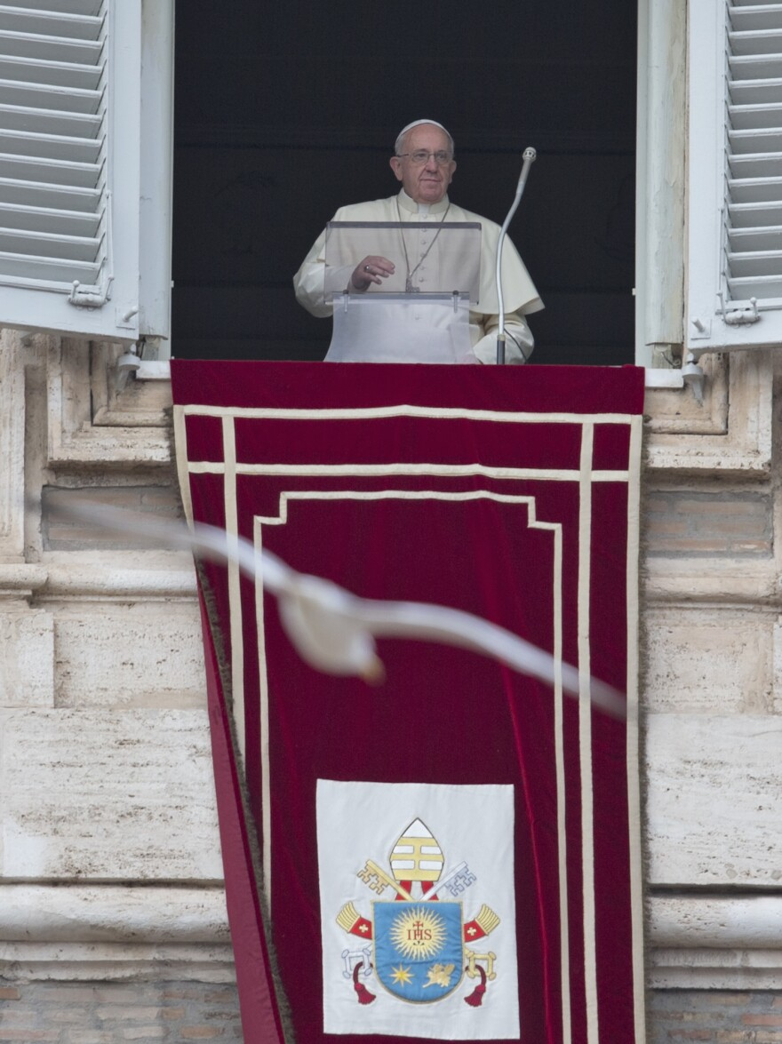 Pope Francis arrives for the Angelus noon prayer Sunday, during which he announced he would travel to Israel, the West Bank and Jordan on May 24-26. It would be Francis' first visit to the Holy Land.
