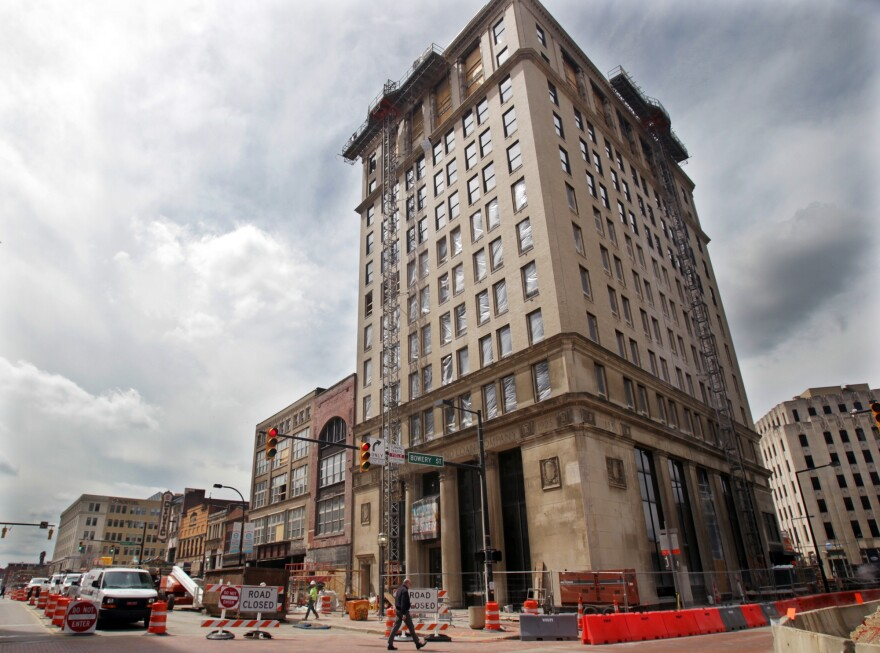 The 12-story Landmark building at the corner of South Main and Bowery is pictured as work goes on at the 42 million dollar Bowery redevelopment project on Wednesday, April 10, 2019 in Akron, Ohio.