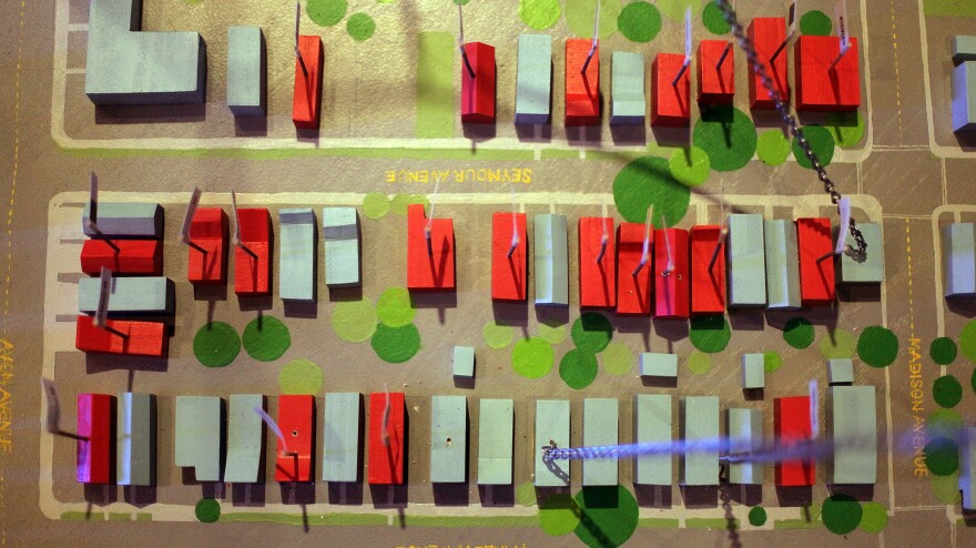An artist's installation shows pre-foreclosed homes in Newark, N.J., in July 2009 at the Queens Museum of Art in New York City.