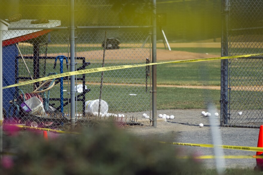 Softballs are strewn on a field at the scene of a multiple shooting involving a member of House Majority Whip Steve Scalise of La., Wednesday, June 14, 2017, in Alexandria, Va.  (Cliff Owen/AP)