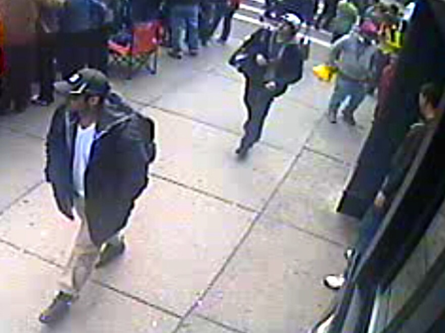 This image from a surveillance video, taken near the finish line of the Boston Marathon, helped investigators identify Tamerlan Tsarnaev (in black cap) and his brother, Dzhokhar (in white cap), as the main suspects in the bombings.