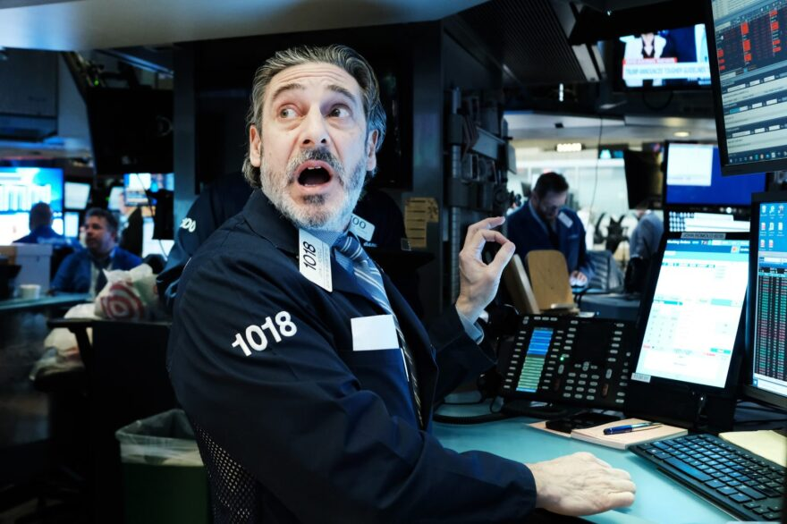 Traders work on the floor of the New York Stock Exchange this week. Stocks fell sharply again despite a drop in interest rates as the nation grapples with the spreading coronavirus outbreak.