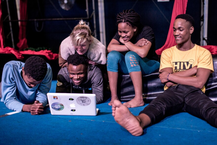 To figure out how to improve their technique, Zip Zap performers watch a video clip after rehearsals at the Zip Zap dome, the Cape Town for the circus.