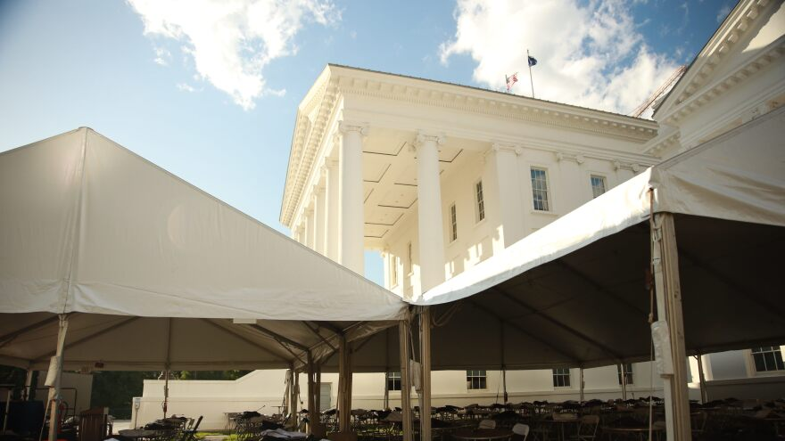 Virginia's House members meet Wednesday in a large event tents on the Capitol grounds, conducing official business at least six feet apart while social distancing measures are still in effect.