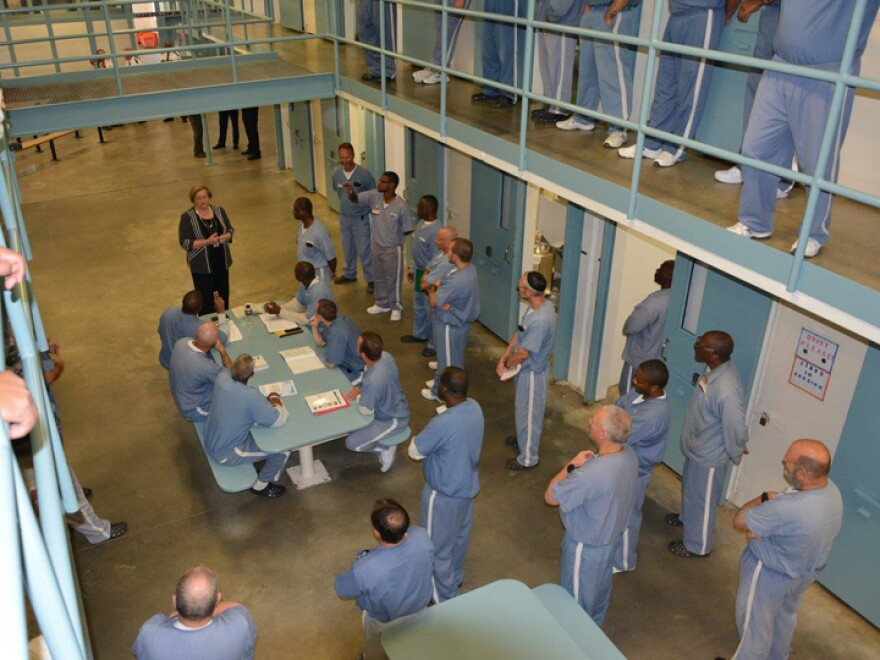 Prisoners crowding around a table