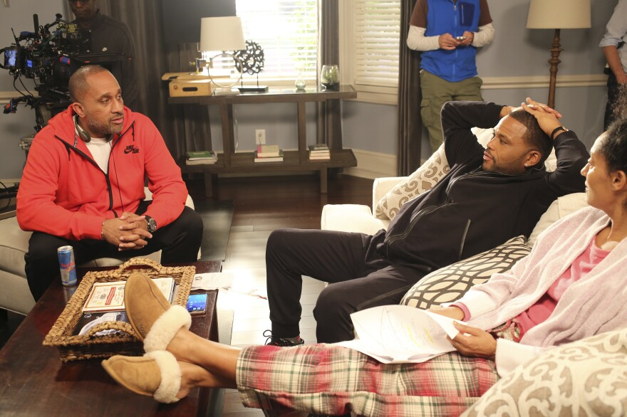 Barris talks to actors Anthony Anderson and Tracee Ellis Ross on the set of <em>Black-ish</em>. Anderson plays Dre, an advertising executive, and Ross plays his wife, Rainbow, who's a doctor.