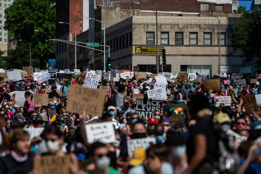Thousands of people marched from St. Louis City Hall to police headquarters and back Sunday, June 7, 2020, as protests over police brutality continue in the region and nation.