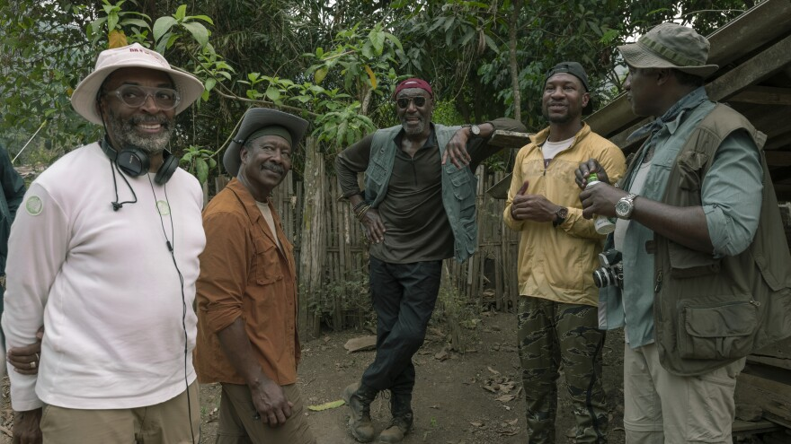 Spike Lee (left) consults with actors Clarke Peters, Delroy Lindo, Jonathan Majors and Norm Lewis on the set of <em>Da 5 Bloods.</em>