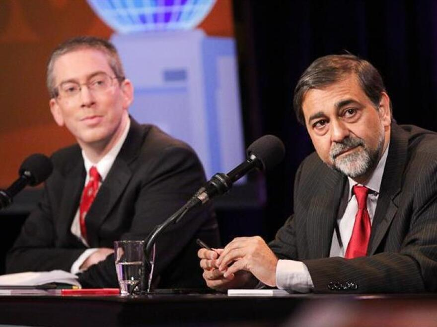 """Bryan Caplan (left) and Vivek Wadhwa argue in favor of the motion """"Let Anyone Take A Job Anywhere."""""""