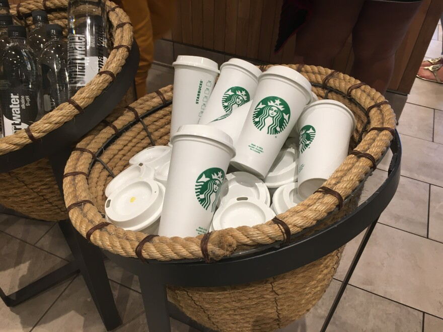 A basket filled with Starbucks cups