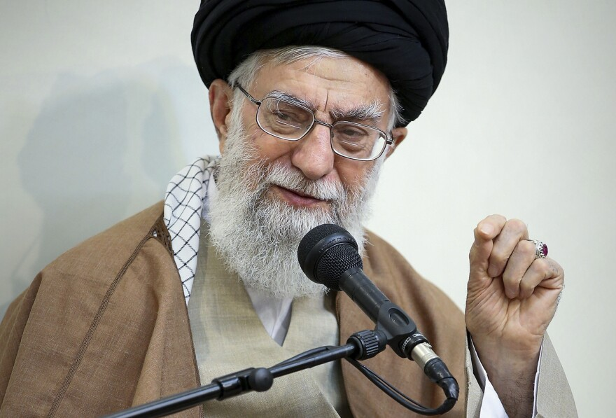 Iran's supreme leader, Ayatollah Ali Khamenei, speaks in a meeting in Tehran on Tuesday. Khamenei said the country's enemies have meddled in recent protest rallies.