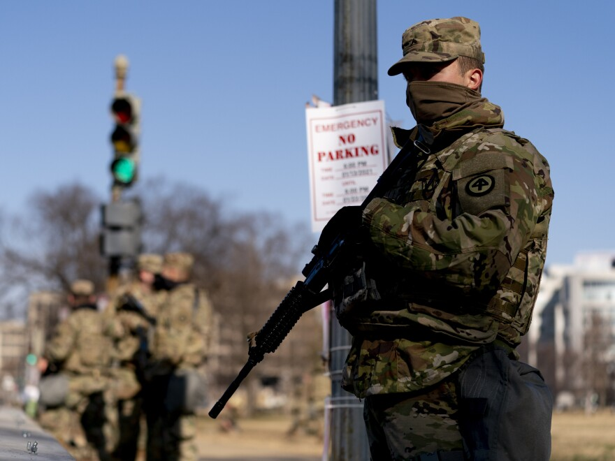 Armed members of the National Guard deployed outside the U.S. Capitol on Thursday.