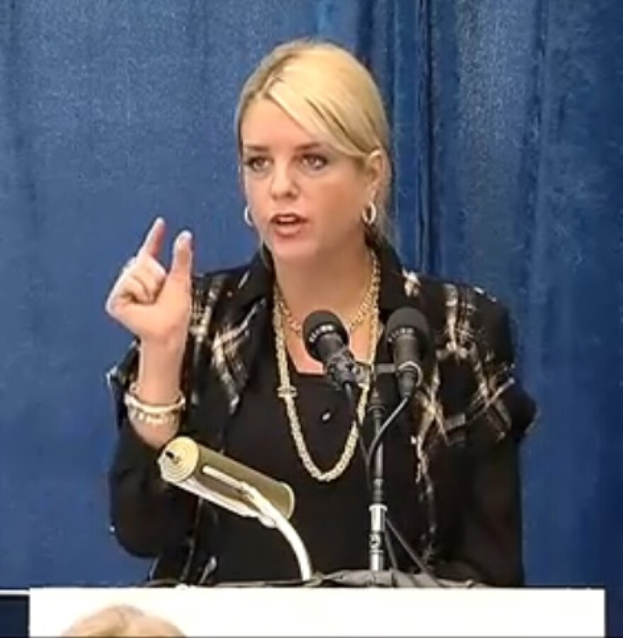 Attorney General Pam Bondi speaking to reporters Wednesday about her backing of a bill allowing certain young sex abuse victims privately record their attackers.