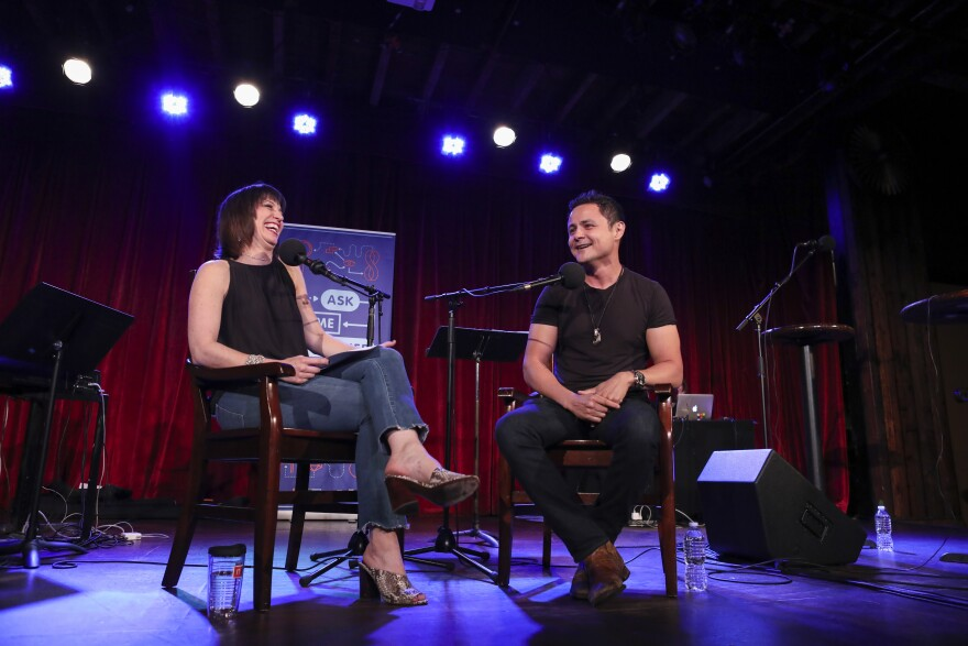 Ophira Eisenberg chats with Arturo Castro on <em>Ask Me Another</em> at the Bell House in Brooklyn, New York.