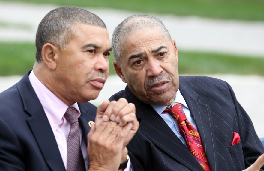 U.S. Rep. Lacy Clay, left, talks with his father, former U.S. Rep. Bill Clay at the ceremony naming the Poplar Street Bridge for the senior Clay.