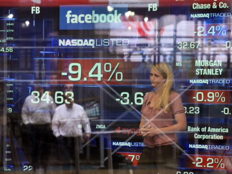 Television correspondent Sabrina Quagliozzi reports from inside the Nasdaq MarketSite in New York's Times Square on Monday.