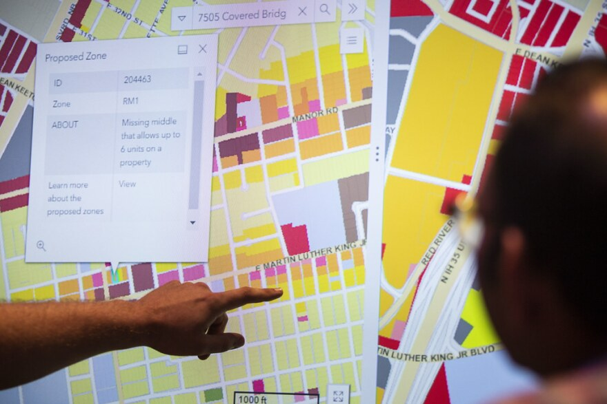 Residents look at maps of Austin's proposed new land development code, at an information session in October.