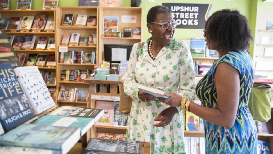 Customers browse at Upshur Street Books, an independent bookshop in D.C.'s Petworth neighborhood. The store, which opened in 2014, is part of a small wave in new or expanding local bookstores. (Tyrone Turner/WAMU)