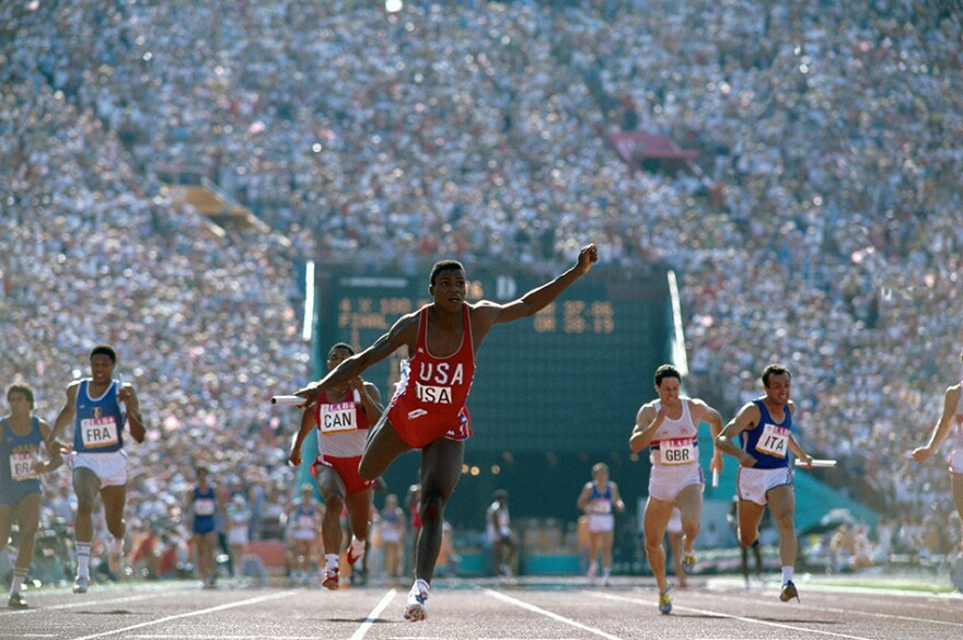 Photograph taken by Leifer at the 1984 Olympics as Carl Lewis set a record during Men's 4x100M Relay and went on to win four gold medals. Photo from <em>Relentless: The Stories behind the Photographs</em>, by Neil Leifer with Diane K. Shah (University of Texas Press, 2016)
