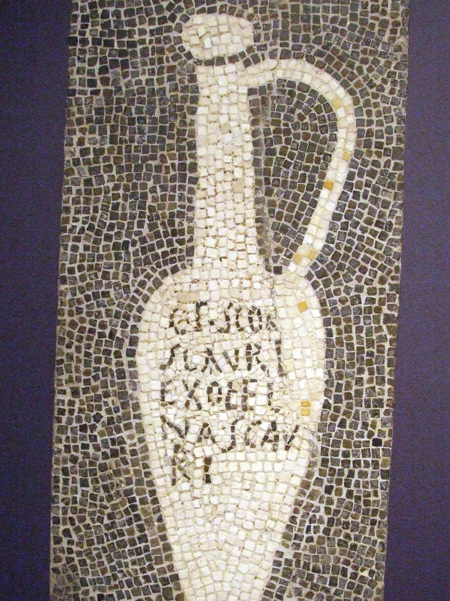 Fish sauce was a staple in Ancient Roman cooking. This mosaic, from Pompeii, would have decorated the floor of a <em>garum</em> shop.