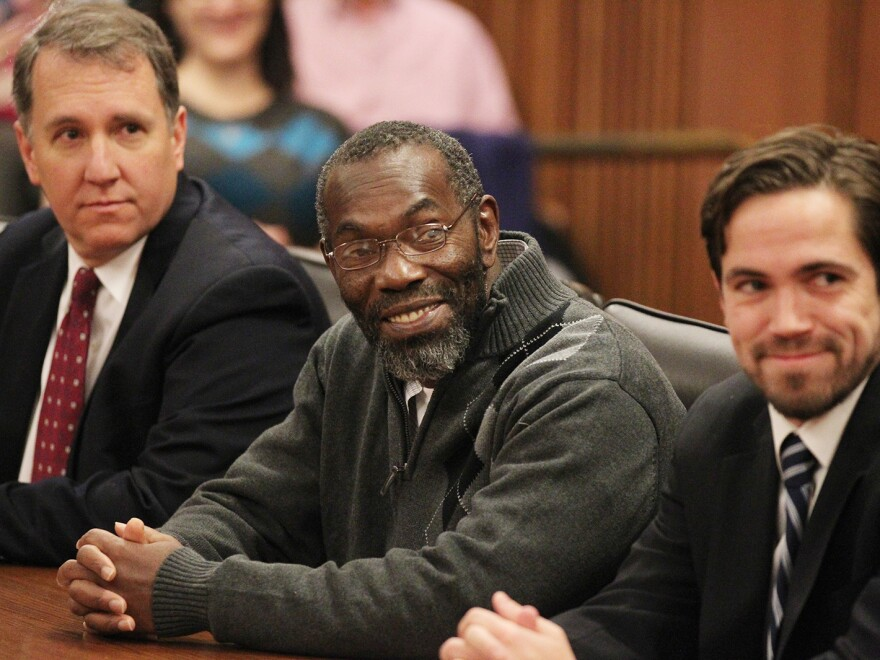 Ricky Jackson (center) smiles as a judge declares him free to leave.