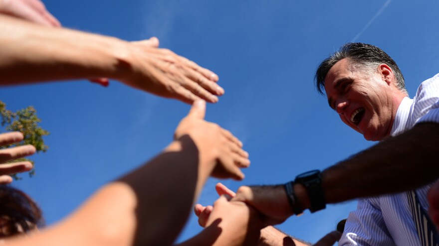 Mitt Romney greets supporters at a campaign rally Wednesday in Chesapeake, Va.