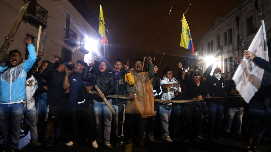 Protesters pack Santo Domingo Square in Quito on Monday night. After the Ecuadorian government scrapped subsidies last week as part of an agreement with the International Monetary Fund, fuel prices leaped more than 100 percent and prompted massive protests.