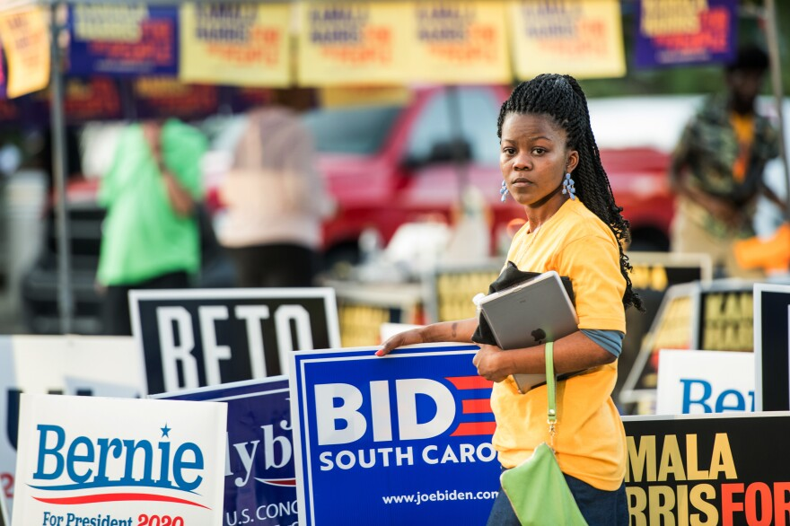 Kanesha Adams stands in the parking lot outside of Jim Clyburn's World-Famous Fish Fry on June 21 in Columbia, S.C. The event featured appearances by 21 Democratic presidential candidates seeking voters in the early primary state.