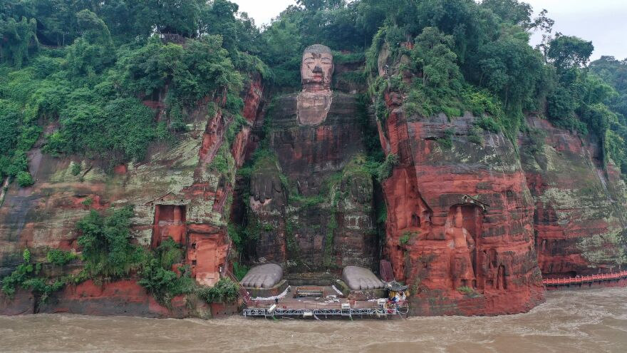An aerial photo shows the Leshan Giant Buddha surrounded by floodwaters following heavy rains in Leshan in China's southwestern Sichuan province on Wednesday.