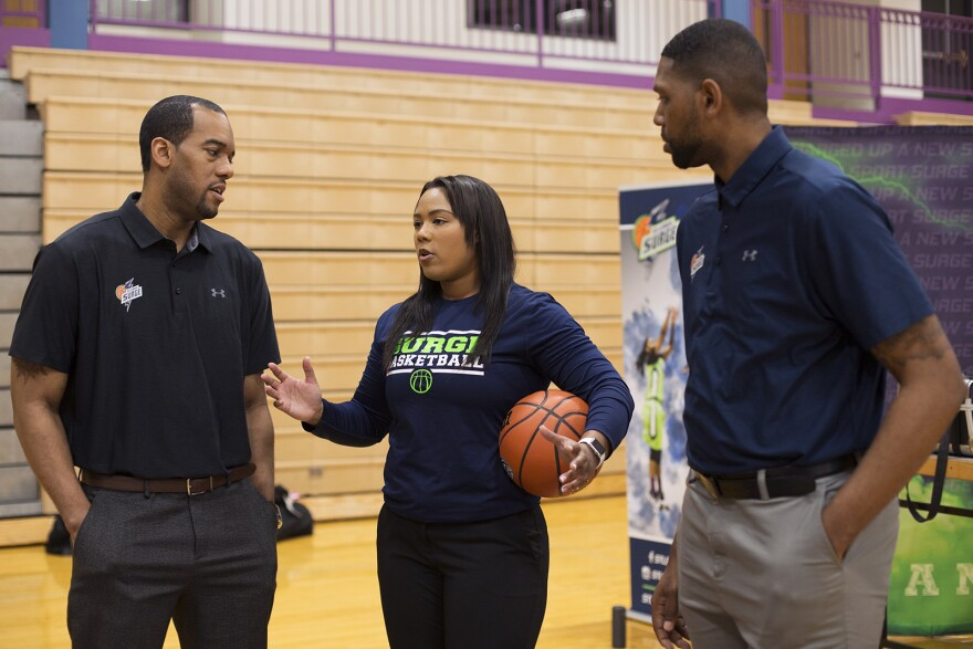 Khalia Collier speaks with head coach  Duez Henderson, left, and assistant coach Robert Kennedy, right.