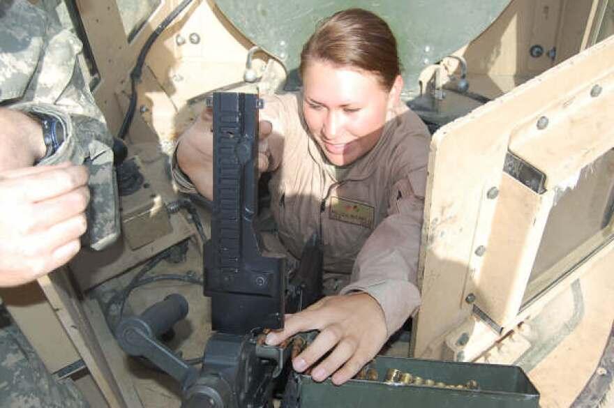 loading_the_m-240_machine_gun_before_mission..jpg
