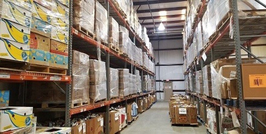 Large boxes are stacked from floor to ceiling at the Second Harvest of the Big Bend warehouse. Donated food is sorted, labeled, packed, and distributed from 41,000 square foot warehouse in Tallahassee.