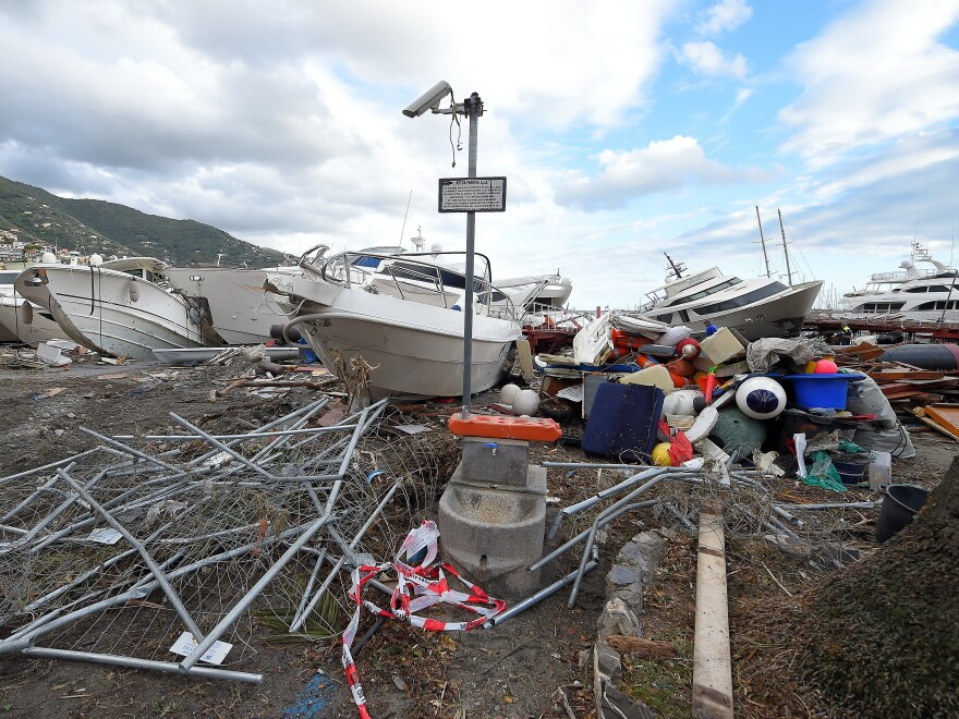 Destroyed yachts lie on the shore after windstorm and the strong sea storm in Rapallo, Italy.