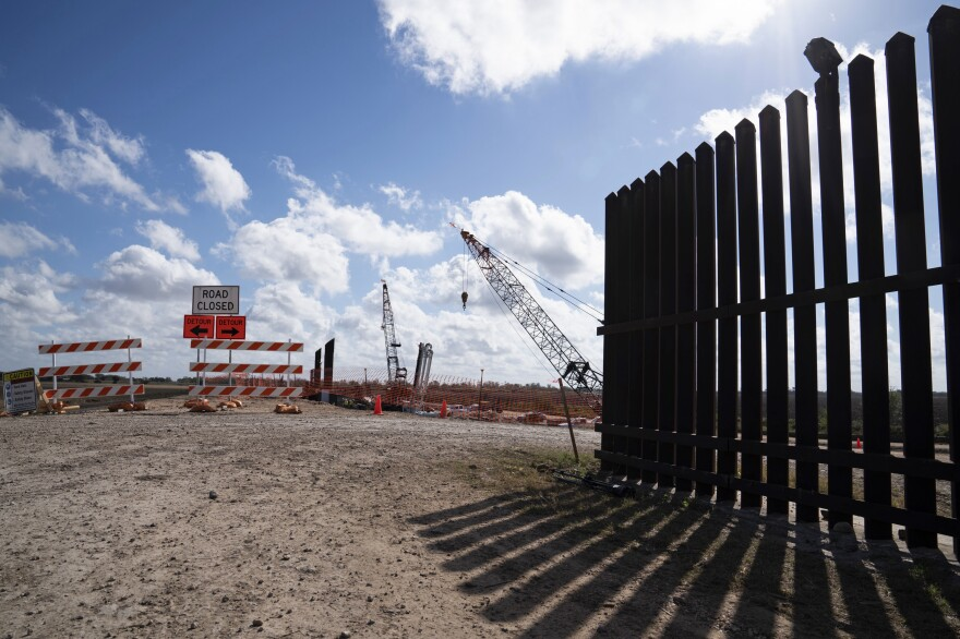 The existing border wall (right) is seen near the construction site of new wall panels south of Donna, Texas, on Nov. 20. There is widespread skepticism on the border that President Trump will get anywhere near the 450 miles of wall he wants by next November.