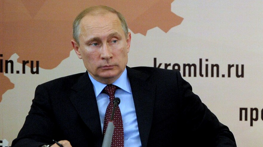 Russia's President Vladimir Putin annexed Crimea from Ukraine and placed Russian troops near that country's eastern border. While the region remains tense, the Russian president, shown here on Monday, says he will respect the results of Ukraine's presidential election.