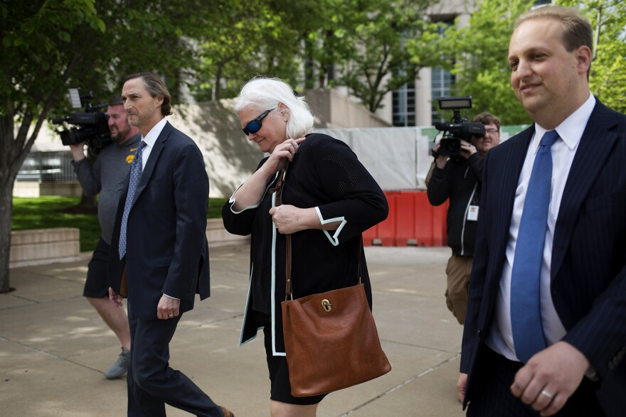 Sheila Sweeney, the former head of the St. Louis Economic Development Partnership, walks out of court after pleading guilty to federal charges Friday.
