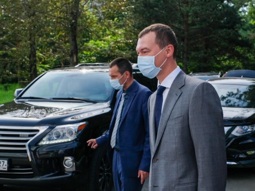 "The acting governor of the Khabarovsk region, Mikhail Degtyaryov (right), visits a local hospital on Thursday. Russian President Vladimir Putin appointed him earlier this month. On his first night on the job, protesters chanted, ""Degtyaryov, go away!"""