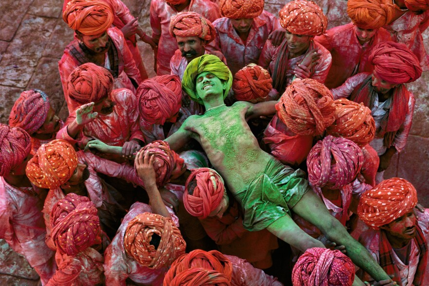 Holi, a festival that welcomes spring, is celebrated with public spraying of colorful powders. Rajasthan, India, 1996.