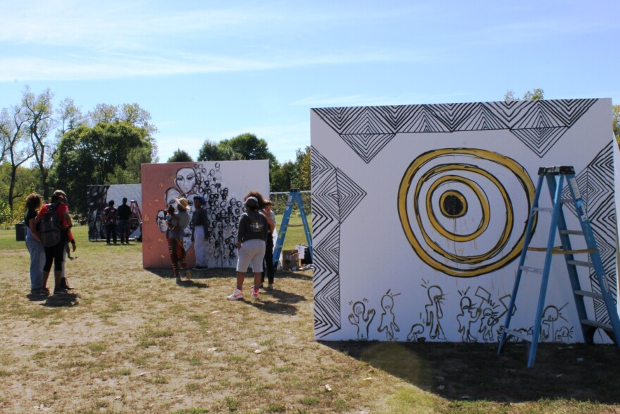 September 30, 2017 photo. By late morning on Saturday, a small group of people gathered to watch artists paint 8 by 10 canvases in Forest Park.