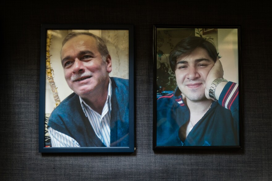 Photos of Mahmoud's husband, Abdelaziz al-Khair (left), and son hang in her apartment in Berlin. For her, the international arrest warrants for top Syrian officials brought some relief.